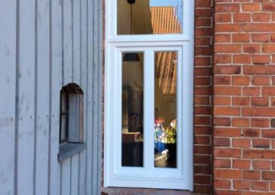 Tischlerei Brümmer - Holzfenster mit festem Oberlicht mit Stichbogen